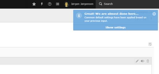 """Benachrichtigungsfenster in TYPO3 mit """"Show Settings""""-Button zum Interagieren."""